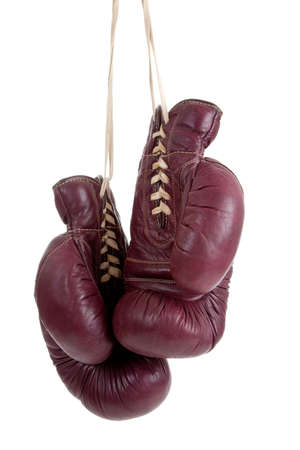 A pair of vintage, antiqe boxing gloves on a white background