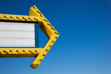 Foto de A drive-in movie marquee in front of a bright blue sky with copy space - Imagen libre de derechos