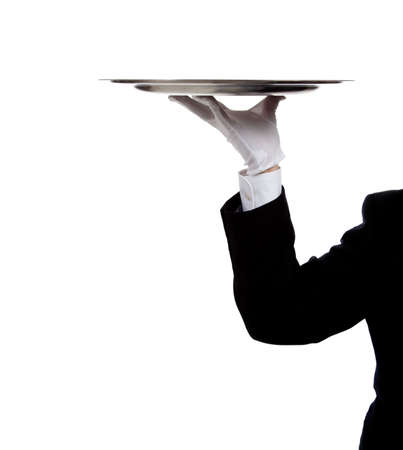 a butler's gloved hand holding a silver tray on a white background with copy space