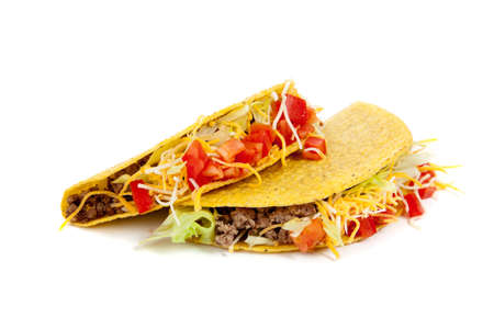 Two tacos on a white background with tomatoes, beef, lettuce and cheese