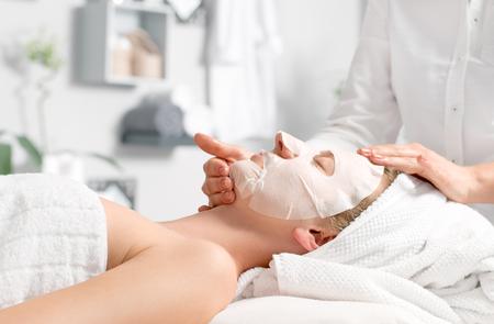 Photo pour Beauty treatment concept.  Woman is getting facial mask  at spa salon - image libre de droit