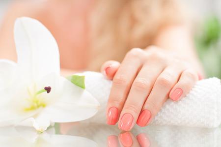 Photo pour Manicure concept. Hand care at the spa. Beautiful woman's hand with perfect manicure at  beauty salon. - image libre de droit