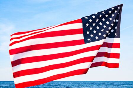 Photo pour American flag on blue sky background. USA Independence day, 4th July. United States flag - image libre de droit