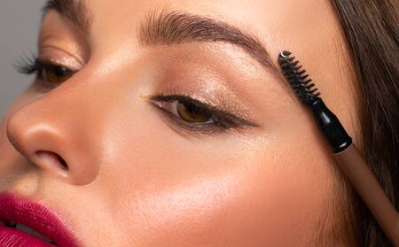 Photo for Beautiful eyes of woman with amazing make up. Girl is applying makeup on eyebrows - Royalty Free Image