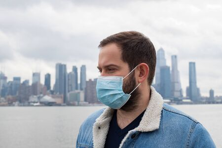 Man is wearing medical protective mask. Health protection prevention during coronavirus epidemic, infectious diseases and air pollution in the city