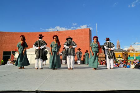 Zacatecas, Mexico, 03 August 2013: A dance group from mexico is performing on stage at the 18th Festival Cultural Internacional Zacatecas del Folclor. It is the biggest international folcloric festival of the Americas with troupes from 19 countries and fr