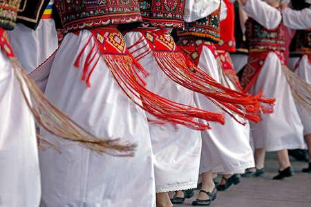 Photo pour Romanian dancers in traditional costume, perform a folk dance. - image libre de droit
