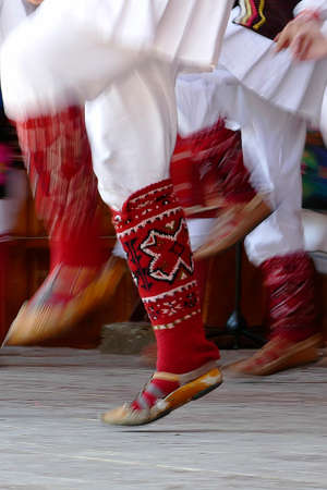 Abstract motion feet of dancers with traditional bulgarian folk dances.