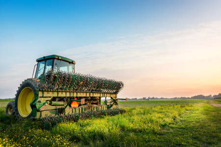 Photo pour Tractor in a field on a Maryland Farm near sunset - image libre de droit