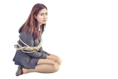 Office lady is bound by a rope without freedom.On a white background isolated