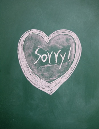 sorry title and heart sign drawn with chalk on blackboard