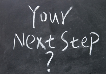 your next step   title written with chalk on blackboard