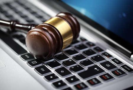 Gavel on laptop computer keyboard concept for online internet auction or legal assistance