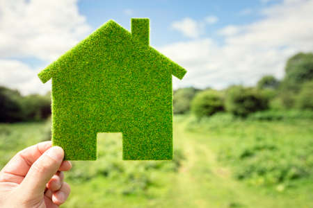 Photo pour Green eco house environmental background in field for future residential building plot - image libre de droit