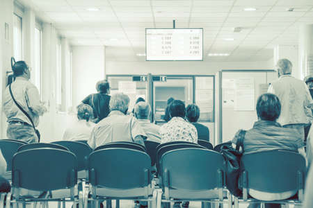 Foto de people waiting for their turn, background image in a waiting room of a hospital (unidentified people) - Imagen libre de derechos