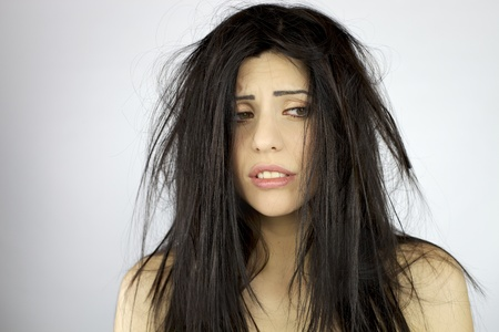 Photo pour Sad and depressed woman with terrible mess on her hair - image libre de droit