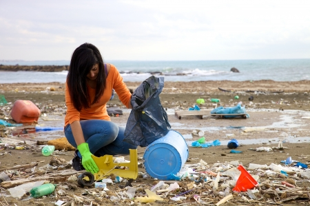 Young activist volunteering on the beach