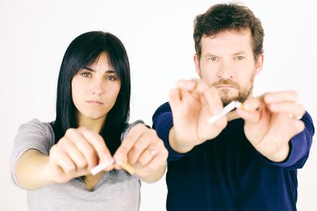 Serious couple deciding to stop smoking