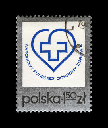 POLAND - CIRCA 1975, JUL 12: canceled stamp printed in Poland, shows Health Fund emblem, National Fund for Health Protection, circa 1975. vintage post stamp isolated on black background.