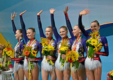 KIEV - AUG 31: 32nd Rhythmic Gymnastics World Championships on August 31, 2013 in Kiev, Ukraine. Belarus gymnasts on medal award ceremony.