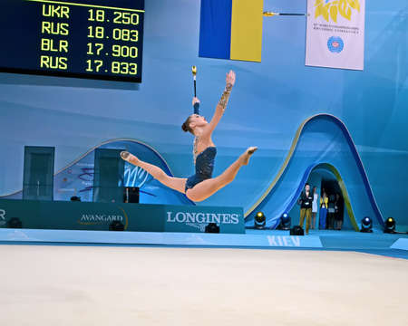 KIEV - AUG 30: 32nd Rhythmic Gymnastics World Championships on August 30, 2013 in Kiev, Ukraine. 56 different nations representing all continents in the tournament. Gymnast take splits in the air.