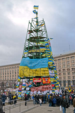 KIEV - DEC 05  Tree construction from flags with slogans on Euro maidan meeting in Kiev on December 05, 2013  Meeting devoted to declining of Ukraine for integration to the European Union
