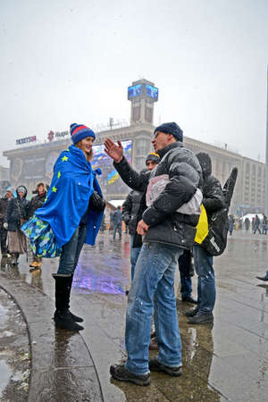 KIEV - DEC 06: People communicate on Euro maidan meeting in Kiev, Ukraine on December 06, 2013. Meeting devoted to declining of Ukraine for integration to the European Union.