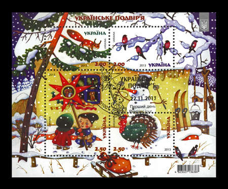 Ukrainian village on Christmas, cancelled stamp printed in Ukraine, circa 2013. vintage post stamp isolated on black background.
