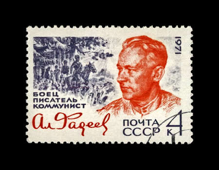 Alexander Fadeyev (1901-1956), famous russian writer, circa 1971. He is best known for his story The Young Guard (Molodaia gvardiia). One of the co-founders of the Union of Soviet Writers. canceled vintage post stamp printed in the USSR isolated on black