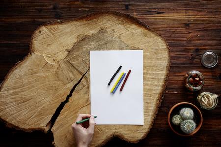Malen auf Holzscheibe