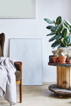 Photo pour modern interior lifestyle in hygge lounge armchair cable drum table and plants - image libre de droit