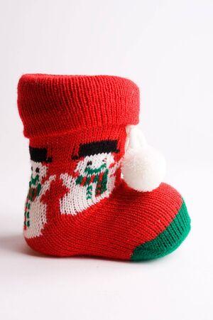 boot of santa claus on white bottom