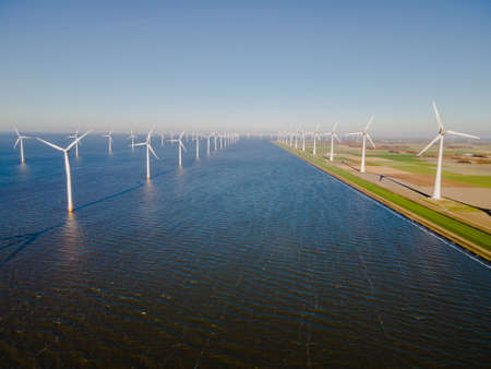 Photo for Windmill park in the Netherlands ocean, Windmill farm with huge turbines green energy in the Netherlands Europe. High wind turbines - Royalty Free Image