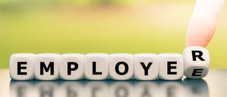 From an employee to an employer. Hand turns a dice and changes the word employee to employer.