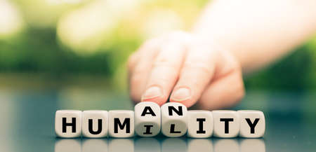 Photo pour Dice form the words humility and humanity. - image libre de droit