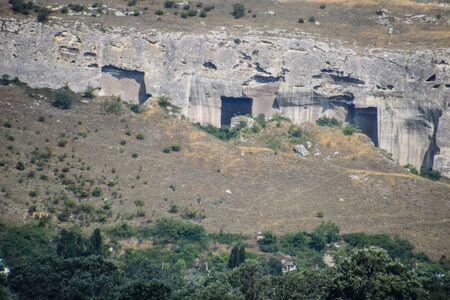 Ancient quarries in the rocks. Evidence of an ancient highly developed civilization. Crimean peninsula.