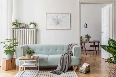 Foto de Stylish scandinavian living room with design mint sofa, furnitures, mock up poster map, plants and elegant personal accessories. Modern home decor. Open space with dining room. Template Ready to use. - Imagen libre de derechos