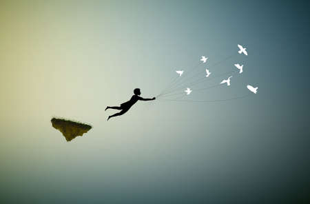 boy is flying away and holding pigeons, fly in the dream land,fly away, shadows, life on flying rock, silhouette.