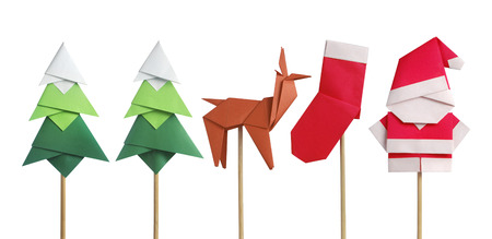 Photo pour Handmade origami paper craft Santa Claus, green Christmas trees, reindeer and stocking isolated on white - image libre de droit