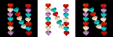 Isolated Font English or Latin Letter N made of colorful glass hearts on white and black backgrounds and with sparkles