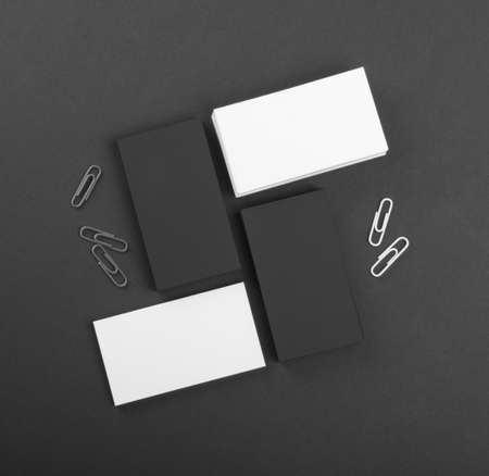 identity design, corporate templates, company style, black and whote business cards on a black background