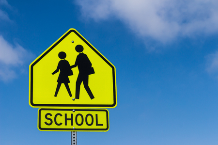 School Warning Sign with the sky background