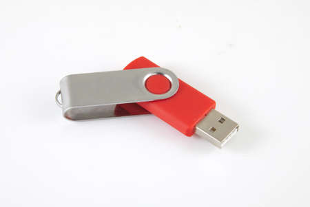 Red USB Stick on a white background.