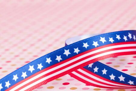 american flag bow on a dotted background