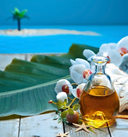 Tropical island retreat essential oil spa treatment with natural plant extracts and orchids