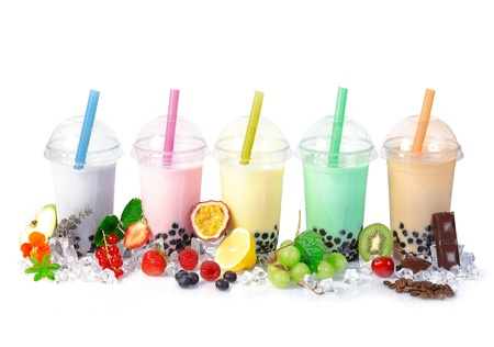Various Bubble Tea in a row isolated on white background with different fruits