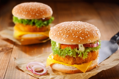 Fast food meanl made of two tasty hamburgers with meat, cheese, onion and salad