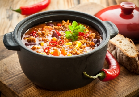Tasty spicy chili con carne casserole in a pot for those winter nights, high angle view