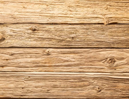Rustic background of very rough textured weathered wooden planks with knots in a horizontal parallel pattern