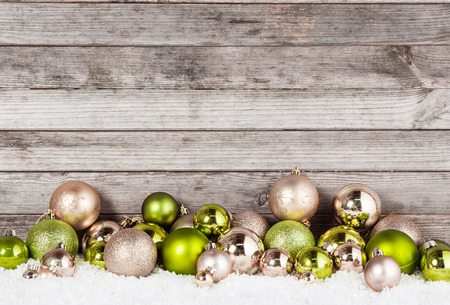 Close up Plenty of Stunning Green and Brown Christmas Ball Ornaments for Holiday Season with Vintage Wall Background.